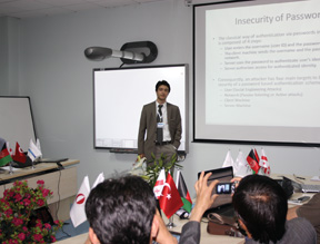 An instructor from Georgia teaches a class to a group of Afghan cyberprofessionals.