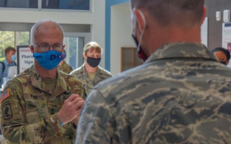Lt. Gen. Ronald Place, USA, director of the Defense Health Agency (DHA), speaks with a U.S. Airman assigned to the 4th Medical Group at Seymour Johnson Air Force Base, North Carolina, in August. The director is leading the DHA's efforts to improve the care of warfighters, including through the use of advanced technology, where appropriate. Credit: U.S. Air Force photo by Senior Airman Kylee Gardner