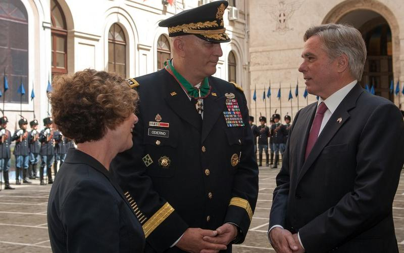 Gen. Raymond T. Odierno, USA (Ret.) (c) , and his wife, Linda (l), speak in 2013 with David Thorne, former U.S. ambassador to Italy, during a ceremony at the Italian army headquarters in Rome, when Gen. Odierno received the Order of Merit of the Italian Republic. The general passed away last weekend at age 67. Credit: U.S. Army photo by Staff Sgt. Teddy Wade
