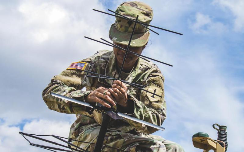 A soldier helps set up a tactical command post to test communications in Germany, July 8, 2019.  Photo by Army Sgt. Patrick Jubrey