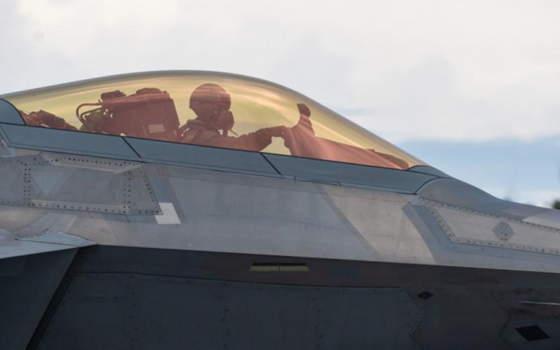 A U.S. Air Force pilot sits in an F-22 Raptor on Northwest Field, Guam, in July during Operation Pacific Iron 21. The operation increased the abilities of airmen, including fighter pilots, outside of their primary roles, as the service grows multi-capable warfighters. Credit: Air Force photo by Senior Airman Alexandra Minor.