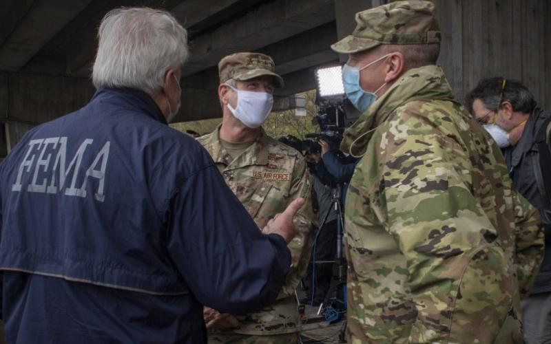 FEMA Regional Administrator Thomas Von Essen and Maj. Gen. Bill Hall, USA, former commander, Joint Task Force Civil Support, during a visit to New York City and USNS Comfort in April 2020. The U.S. Northern Command, which responds to domestic humanitarian crises, and the other combatant commands could expand the use of artificial intelligence through specialized teams at each command. Credit: U.S. Navy photo by Specialist 1st Class Kleynia McKnight
