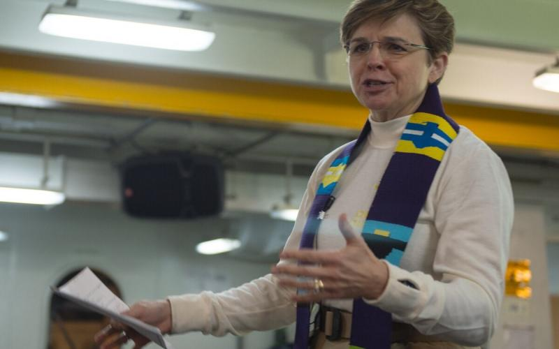 In 2015, Rear Adm. Margaret Kibben, then Navy chief of chaplains, leads a service for sailors in the forecastle of the aircraft carrier USS Carl Vinson.  U.S. Navy photo by Mass Communication Specialist 3rd Class James Vazquez/Released
