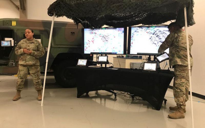 The Army's SFC Sheena Ferrell (l) and SFC Ramon Contreras, both from the National Training Center, Fort Irwin, California, demonstrate the new Tactical Computing Environment developed by CERDEC.