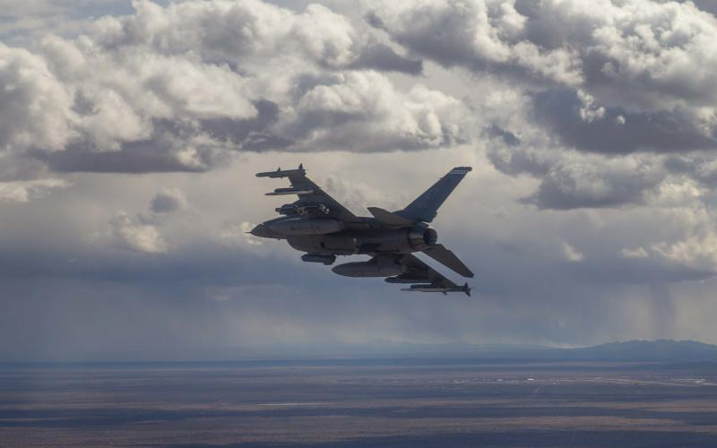 A 40th Flight Test Squadron F-16D Fighting Falcon prepares to drop four bombs for the second Golden Horde test mission designed to provide proof of concept for collaborative autonomous weapons.  U.S. Air Force photo by Tech. Sgt. John Raven, USAF