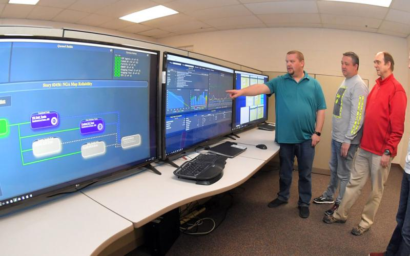 Engineers from the 517th Software Engineering Squadron, including (l-r) Carl Stuck and Scott Vigil, project directors; David Jolley, director; and Brent VanDerMeide, flight director, have created a new software development platform. U.S. Air Force photo by Todd Cromer
