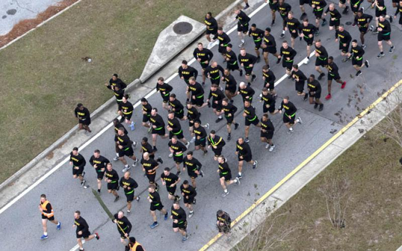 Army soldiers from the 3rd Infantry Division participate in a 4-mile division run at Fort Stewart, Georgia. The use of fitness trackers by some soldiers is inadvertently revealing their location and outline of military bases. Army photo by Sgt. Caitlyn Smoyer