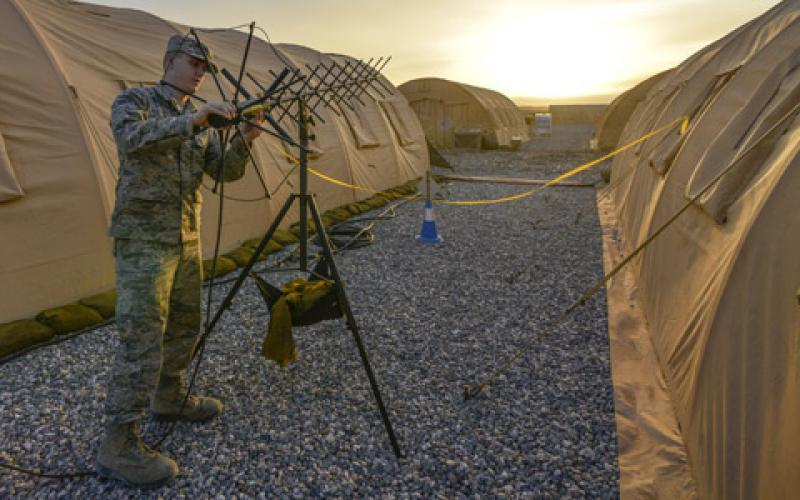 A U.S. Air Force tactical network operations technician adjusts an AV-211 antenna at Diyarbakir Air Base, Turkey. The latest networking techniques, such as software-defined wide area networks, may offer both budgetary and operational benefits for the Defense Department.