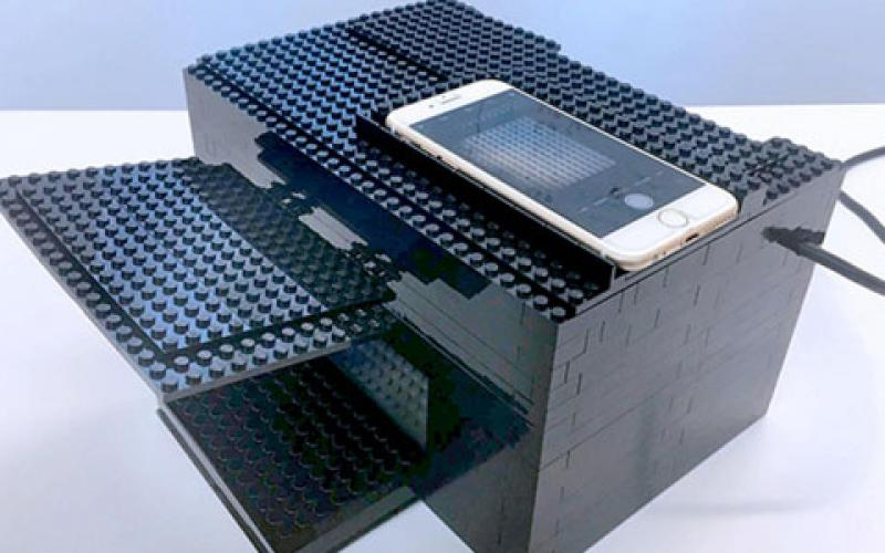 Researchers at the University of Texas at Austin have created a nerve gas detector using a smartphone, a box made of Legos and a chemical sensor. Credit: University of Texas at Austin