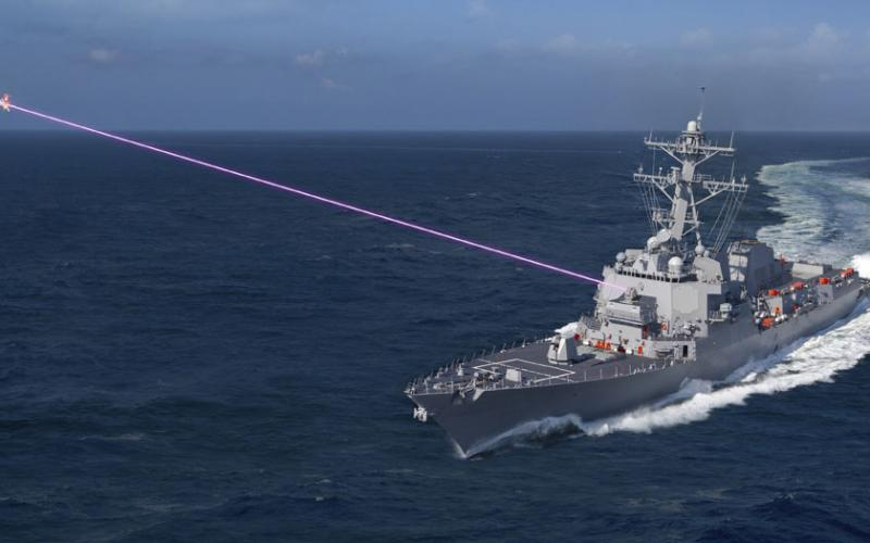 Under the High-Energy Laser and Integrated Optical-dazzler with Surveillance (HELIOS) program, the Navy is swiftly pursuing laser weapons for use on surface ships. The technology will combine the lethality of a laser weapon with surveillance capabilities and an integrated optical dazzler, a non-lethal device that disables sensors or humans visually. Photo Credit: Lockheed Martin, artist rendering of Lockheed Martin's HELIOS System