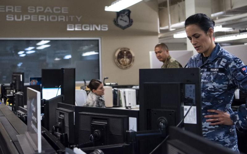 Squadron Leader Jamiee Maika, Royal Australian Air Force, observes operations at the Combined Space Operations Center at Vandenberg Air Force Base, California. This multinational space force includes a strategic defense partnership between the United States, Canada, Australia and the United Kingdom. Additional nations collaborating on space operations with the center include Germany, France and New Zealand. U.S. Space Force photo by Staff Sgt. J.T. Armstrong