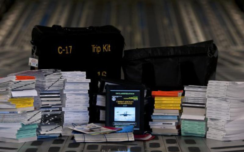An electronic flight bag (center) replaces the paper flight manuals and products that can weigh nearly 120 pounds.