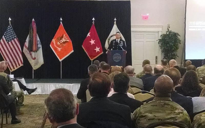 Brig. Gen. (P) Brian J. Mennes, USA, director of force management, HQDA, deputy chief of staff, G-3/7, describes the operational environment at the AFCEA Army Signal Conference in Springfield, Virginia.