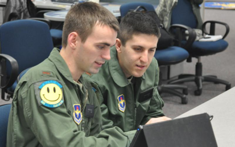 U.S. Air Force students use a tablet for training and education. The Defense Information Systems Agency is supplying tablets to senior leaders under the one-year pilot program.