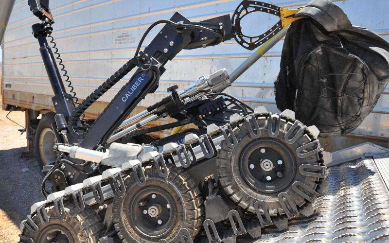 A bomb disposal robot removes a suspicious package during a training operation at Sandia National Laboratories. (Photo by Randy Montoya)