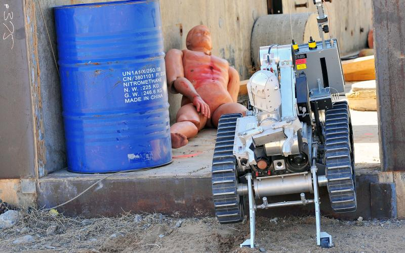 A robot performs a rescue operation on a dummy victim during a training exercise at a previous Robot Rodeo. (Photo by Randy Montoya)