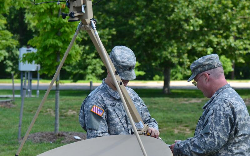 Soldiers with the 4th Battalion, 3rd U.S. Infantry Regiment (The Old Guard) and the Alabama Army National Guard assemble a VSAT, similar to the one Army Medical Command personnel rely upon for telemedicine support when forward-deployed.