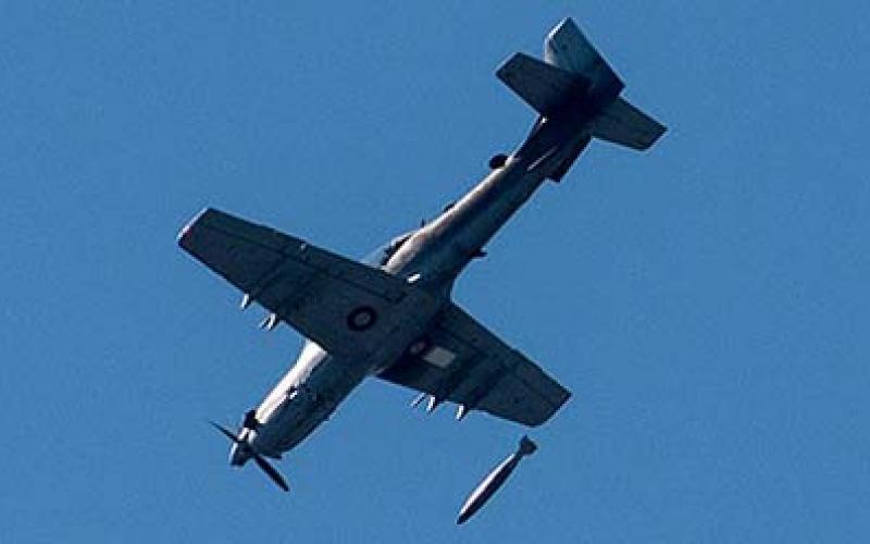 An A-29 Super Tucano drops a bomb.