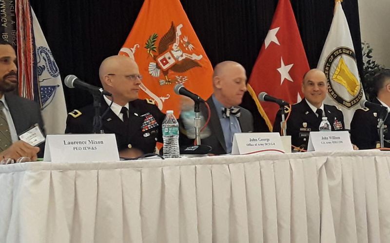 Panelists discuss military technology acquisition at the AFCEA Army Signal Conference.