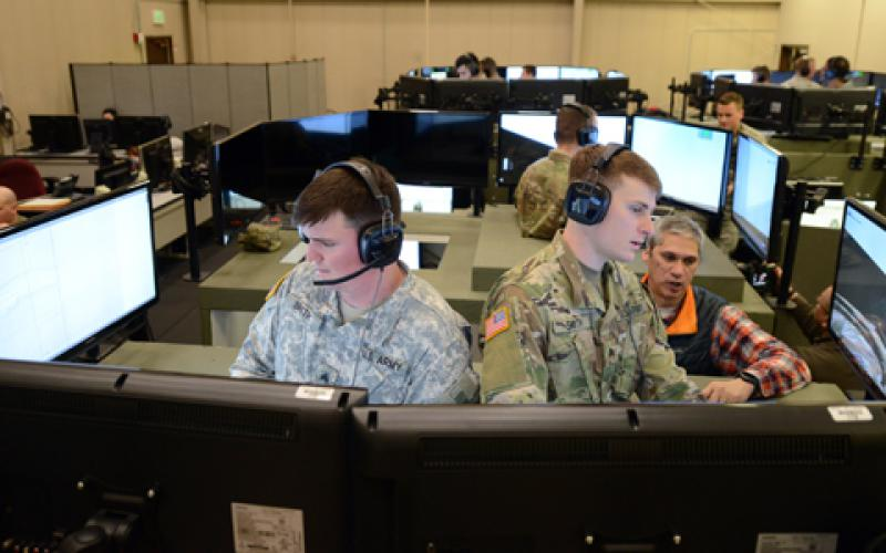 Soldiers train in a Stryker Virtual Collective Trainer at the Mission Training Complex on Joint Base Lewis-McChord, Washington. The system was recently fielded to Vilseck, Germany, the first fielding in Europe.   Credit: C. Todd Lopez