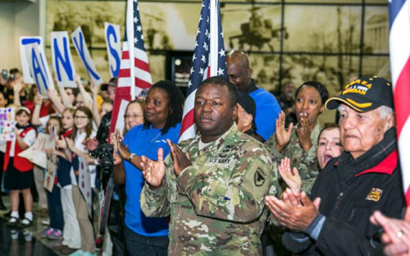Veterans, active duty military and civilians welcome wounded warriors from all over the country to Huntsville International Airport in Alabama in commemoration of Veterans Week in November. Big data corporation Splunk is partnering with nonprofit veterans' organizations to make a difference in getting veterans back to work. Army photo by Sgt. 1st Class Teddy Wade.