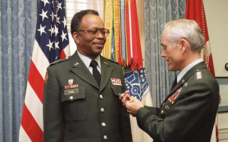 Gen. John A. Wickham Jr., USA (Ret.), then Army chief of staff (r), presents the U.S. Army's Distinguished Service Medal to Lt. Gen. Emmett Paige Jr., USA (Ret.), then commander, U.S. Army Information Systems Command, during a 1986 ceremony at the Pentagon. (Defense Department photo by Scott Davis)