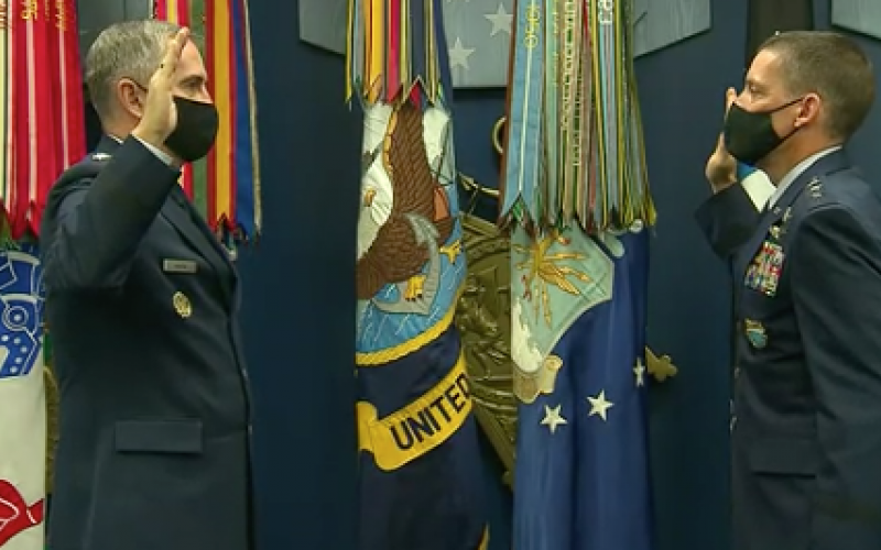 The vice chairman of the Joint Chiefs of Staff, Gen. John Hyten, USAF (l), promotes Robert Skinner, USAF (r), to lieutenant general in advanced of Skinner's move to lead the Defense Information Systems Agency and commander, Joint Force Headquarters Department of Defense Information Networks.