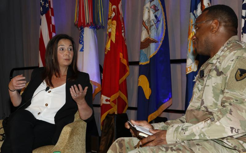 Jennifer Swanson, director, Software Engineering Center, Army Communications-Electronics Command (CECOM) and CW5 Linc McCoy, USA, CECOM's command chief warrant officer, have a fireside chat during TechNet Augusta 2021.