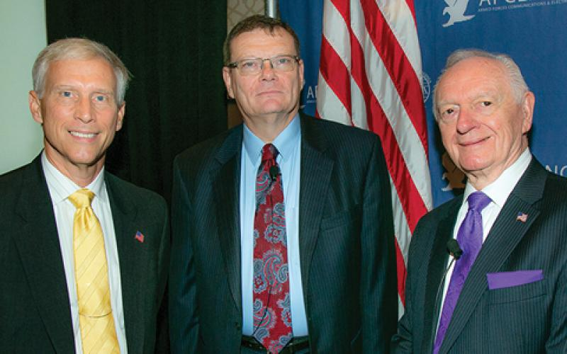 Chuck Corjay (r) and David Scarbalis (l), former chapter president, welcomed speaker Terry Halvorsen, then-Defense Department chief information officer, to the NOVA Chapter's Joint Warfighter IT Day in September 2016.