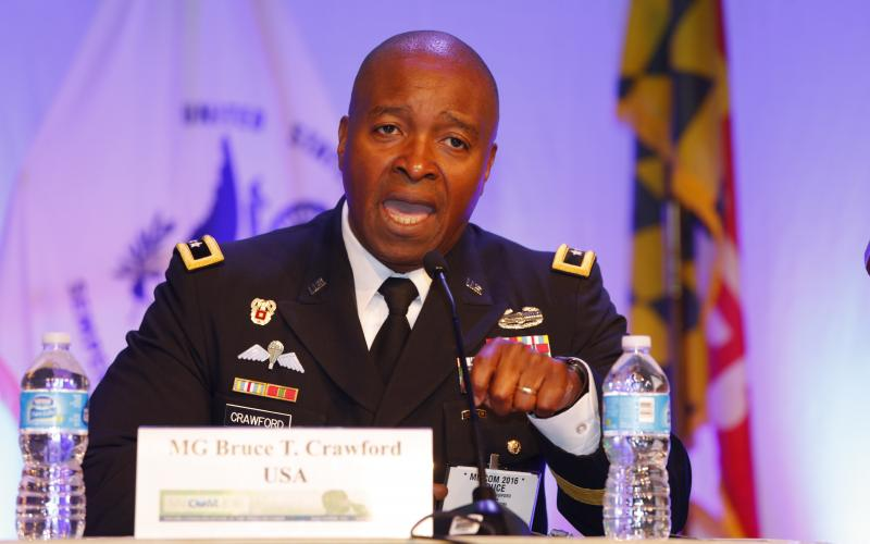 Maj. Gen.  Bruce Crawford, USA, commanding general of U.S. Army Communications-Electronics Command (CECOM), speaks on a panel during MILCOM 2016. Photo by Mike Carpenter