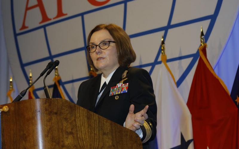 Rear Adm. Kathleen Creighton, USN, deputy commander, JFHQ-DODIN, moderates a panel at DCOS.