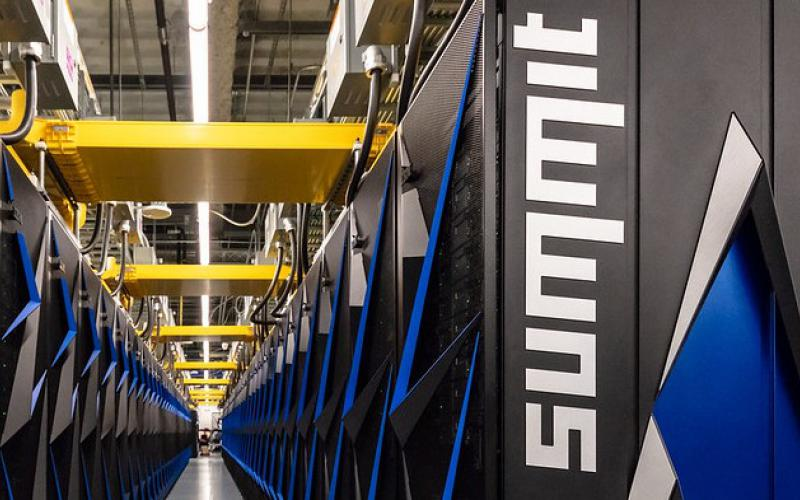 The Summit supercomputer at Oak Ridge National Laboratory is modeling the effects of drug molecules to stop the COVID-19 coronavirus. Credit: Carlos Jones/ORNL
