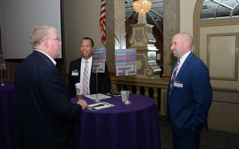 Llewellyn Means (c) and Stephen Wallace (r) speak with an industry official during DISA's 2019 Forecast to Industry. The agency is planning to virtually present this year's Forecast the week before the virtual TechNetCyber Cyber conference December 1-3. Credit: DISA