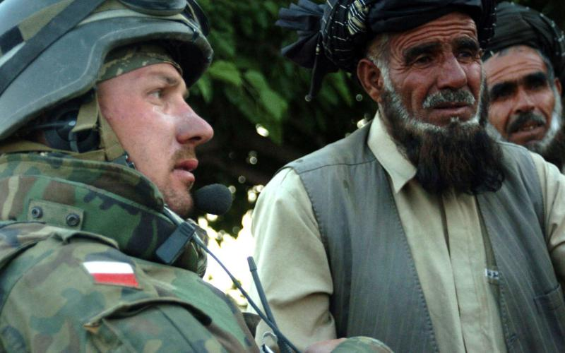 A Polish army officer talks with village elders in the Ghazni province of Afghanistan. U.S. Army officials are discussing the need to include international partners and allies in the Joint All-Domain Command and Control concept, which is expected to dramatically improve interoperability. U.S. Army photo by Spc. Micah E. Clare