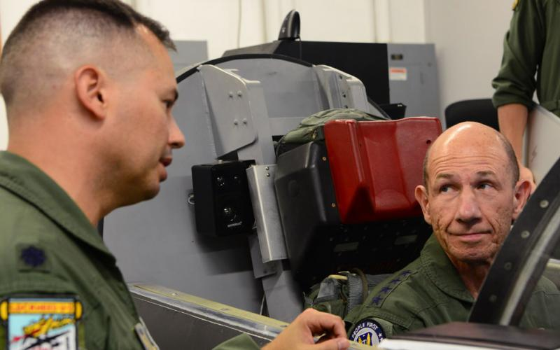 Gen. Mike Holmes, USAF, commander of Air Combat Command (r), receives a brief on U-2 Dragon Lady ejection procedures from Lt. Col. Charles, 9th Operations Group deputy commander, at Beale Air Force Base, California. Holmes visited the 9th Reconnaissance Wing, where he was immersed in all aspects of the reconnaissance mission. U.S Air Force photo by Senior Airman Tristan D. Viglianco