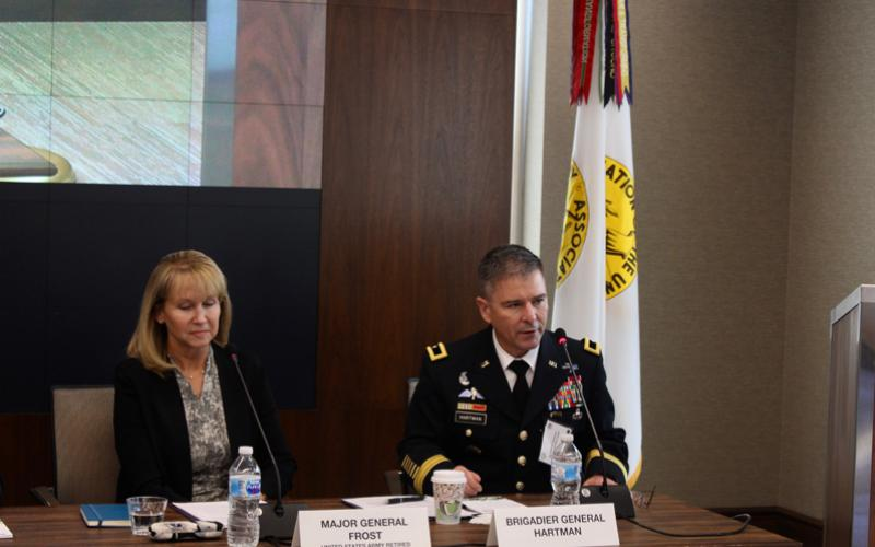 Newly retired Maj. Gen. Patricia Frost, USA, and Brig. Gen. William Hartman, USA, deputy commanding general, U.S. Army Cyber Command, discuss lessons learned from the establishment of the Army's Cyber-Electromagnetic Activities (CEMA) teams. Photo credit: Anna Neubauer