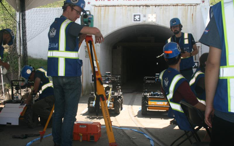 Researchers from the Jet Propulsion Lab, California Institute of Technology, Massachusetts Institute of Technology and South Korea's KAIST Center, representing the CoStar Team, await to deploy additional ground robots into the coal mine tunnel on August 20 during DARPA's Subterranean Challenge.