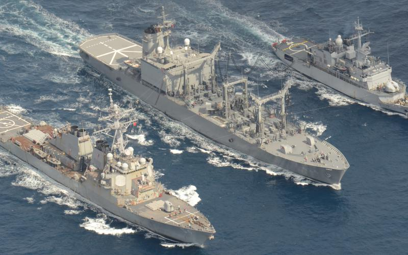 The USS Wilbur (l) conducts replenishment at sea with Japanese and French ships. The U.S. Indo-Pacific Command is expanding its exercise and training activities with allies and partners to boost its deterrent capabilities across the vast region.  U.S. Navy courtesy of Japan Maritime Self-Defense Force