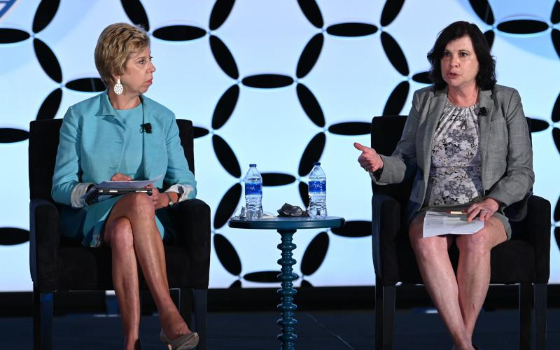 Ellen Lord (l), former undersecretary of defense for acquisition and sustainment, discusses the vulnerability of the supply chain with Christine Michienzi, chief technology officer for the Office of the Deputy Assistant Secretary of Defense for Industrial Policy, at the Intelligence and National Security Summit. Photo by Herman Farrer