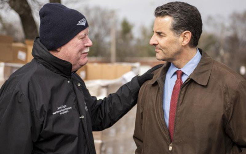 Rep. Paul Sarbanes (D-MD) (r) speaks with Joe Flynn of the American Federation of Government Employees about how the shutdown is affecting his organization's members