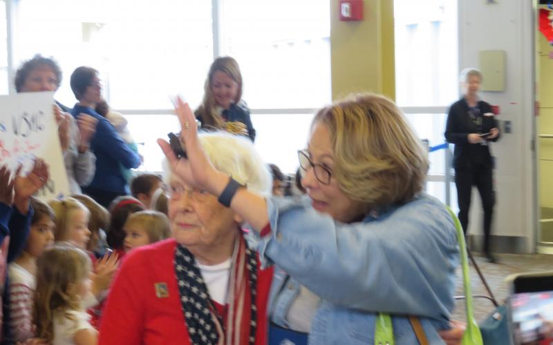 Vice Adm. Nancy Brown, USN (Ret.), and Pat Bixler (l), a nurse during World War II, take in the excitement generated from hundreds of greeters upon the arrival of the Honor Flight.