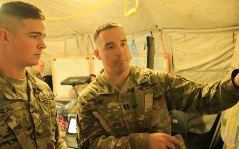 2nd Lt. Shane Neal, USA, receives guidance from Capt. Douglas Gain, USA, as they review the Cyber and Electromagnetic Activities Team's plans during Exercise Saber Junction 2019 at the Grafenwoehr Training Area, Germany. Credit: U.S. Army