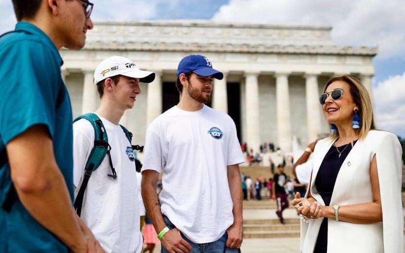 Dr. Irma Becerra, president, Marymount University (r), chats with students in front of the Lincoln Memorial during a fall orientation event in August 2018.  Photo by Marymount University