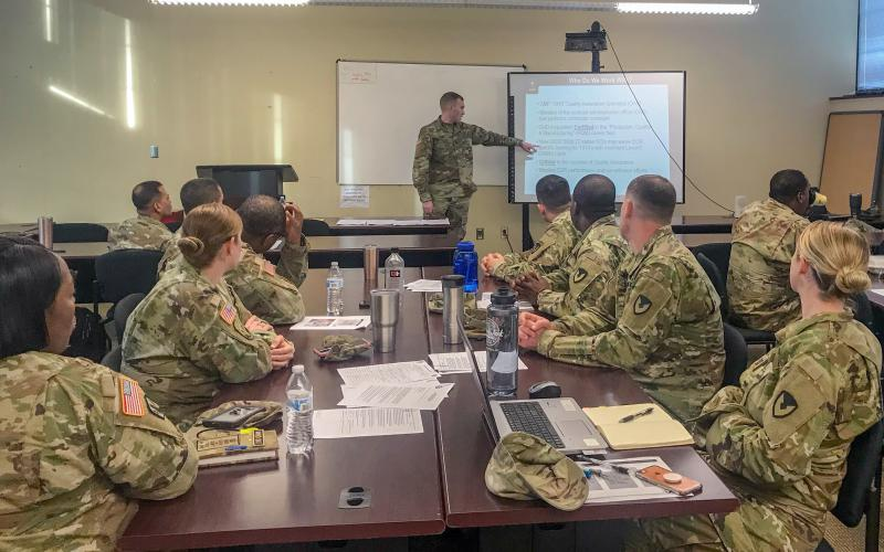 Capt. David Ray, USA, leads a quality assurance class for soldiers during a contingency contract administration services training event. Credit: Photo by Sgt. 1st Class Terry Ann Lewis