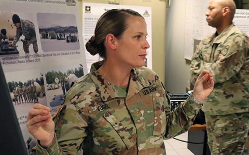 Maj. Jennifer Vogel, USA, explains the benefits of the Transportable Tactical Command Communications (T2C2) capability to SIGNAL Magazine and other reporters during a recent visit to the PEO C3T.