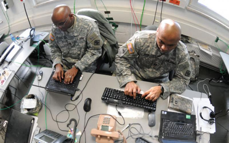 U.S. soldiers work on a Mission Event Synchronization List in the Joint Cyber Control Center during Operation Deuce Lightning in 2011.
