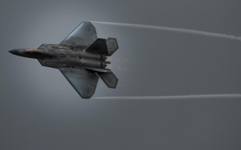 """The Air Combat Command is on its way to being the U.S. Air Force's """"lead command for cyberspace superiority"""" while it maintains its more traditional role of providing air combat forces and capabilities, such as this F-22 aircraft, flown by U.S. Air Force Maj. Joshua """"Cabo"""" Gunderson, F-22 Raptor Demonstration Team commander and pilot, during the 2020 Stuart Air Show on November 7, in Stuart, Florida. U.S. Air Force photo by Capt. Kip Sumner"""
