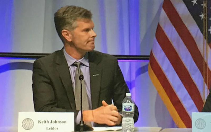 Keith Johnson, chief technology officer and chief engineer, Leidos Defense and Intelligence Group, speaks during a panel session at the AFCEA Defensive Cyber Operations Symposium.