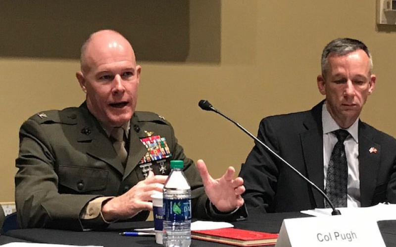 Col. Randolph Pugh, USMC, commanding officer, USMC Intel Schools (l), and Guy Jordan, acting director, Intelligence, USMC, discuss the steps the Marine Corps are taking to elevate electronic warfare during the Association of Old Crows USMC Signals Intelligence Day held on Capitol Hill on April 11.