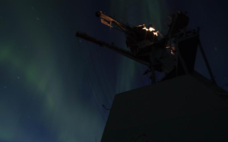 An aurora borealis appears in the night sky over the USS Thomas Hudner during an exercise in the Arctic. U.S. and allied forces are paying greater attention to operations in the Arctic and the North Atlantic in the face of an increased Russian threat. Credit: U.S. Navy photo